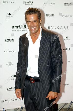 Edoardo Costa attending the Amfar party.