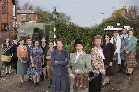 L-R: DAISY BADGER as Claire Hillman, MIKE NOBLE as Spencer Bradley, FRANCES GREY as Erica Campbell, ED STOPPARD as Will Campbell, CLAIRE RUSHBROOK as Pat Simms, BRIAN FLETCHER as Little Stan Farrow, CLARE CALBRAITH as Steph Farrow, RUTH GEMMELL as Sarah King, FRANCESCA ANNIS as Joyce Cameron, SAMANTHA BOND as Frances Barden, LEANNE BEST as Teresa Stockwood, WILL ATTENBOROUGH as David Brindsley, DANIEL RYAN as Bryn Brindsley and CLAIRE PIRICE as Miriam Brindsley.