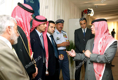King Abdullah II (R) talks to his brothers Crown Prince Hamzeh (3rd from L), Prince Hashem (2nd L), Prince Faisal (3rd from R) during a receiption of the Jordanian tribal leaders for the wedding of his brother Prince Ali Bin Al Hussein to the reporter of the CNN Reem al - Ibrahimi, daughter of the UN special envoy to Afghanistan and Iraq al Akhdar al Ibrahimi