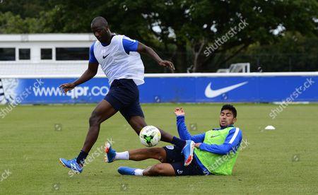 Massimo Luongo of QPR tackles Samba Diakite