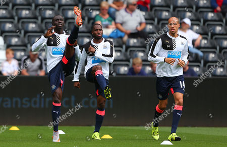 Papiss Demba Cisse, Georginio Wijnaldum and Gabriel Obertan of Newcastle United warm up before the Barclays Premier League match between Swansea City and Newcastle United played at the Liberty Stadium, Swansea