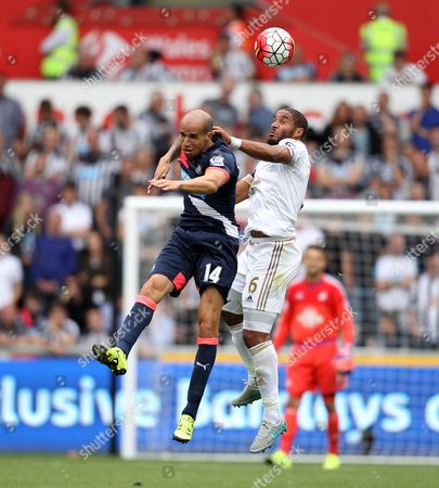 Gabriel Obertan of Newcastle United is beaten to a header by Ashley Williams of Swansea City