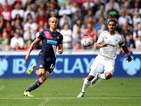 Gabriel Obertan of Newcastle United and Kyle Naughton of Swansea City chase the ball down