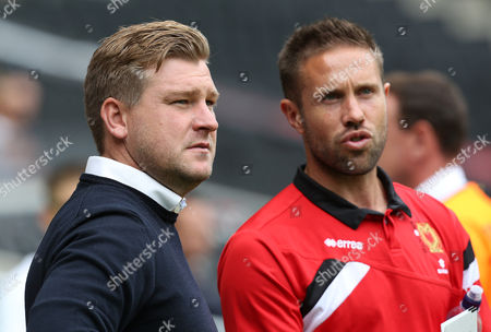 MK Dons manager Karl Robinson talks to Matthew Upson during the Sky Bet League match between MK Dons and Preston North End played at Stadium MK, Milton Keynes
