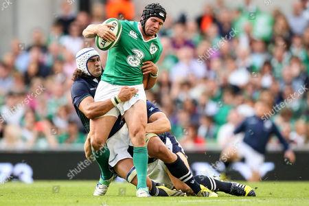 Scotland's Blair Cowan and Ross Ford tackle Isaac Boss of Ireland