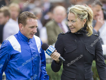 Channel 4 racing presenter Emma Spencer interviews jockey Paul Hanagan