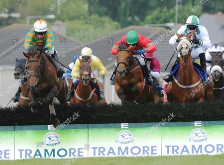 Tramore COLLEN BEAG & Jonathan Burke (Centre) jump the last to win the Richard Power Handicap Hurdle from DO NA PAISTI & Paul Townend (right) and CARIDADI & Paddy Mangan (left)