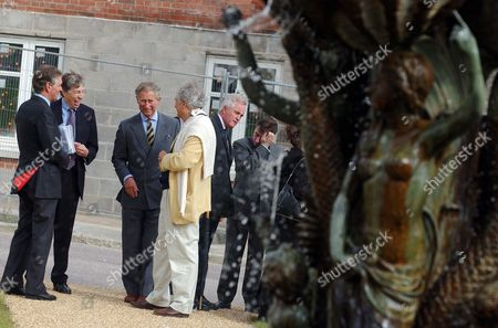 Prince Charles (c) accompanied by Housing and Planning Minister Keith Hill (l) and architect Leon Krier (r)