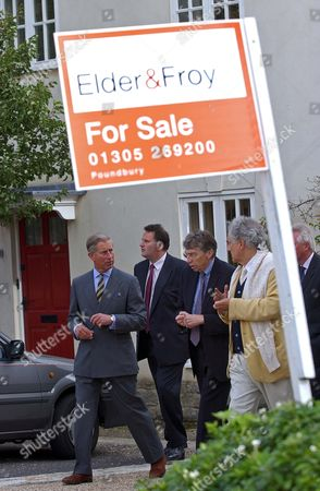 Prince Charles accompanied by Housing and Planning Minister Keith Hill and architect Leon Krier