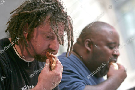 'Crazy Legs' Conti and Eric Booker competing. The contest, sanctionned by the International Federation of Competitive Eaters, determines who can eat the most cannoli within a given 6 minute period. The winner will receive a Championship Belt and will be recognized as The Worlds Champion Cannoli Eater.