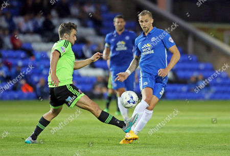 Jack Collison of Peterborough United in action with Jose Baxter of Sheffield United