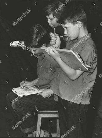 Editorial image of (back-front) Michele Peter And Michael Painting At Marble Arch. They Are The Children Of Actress Binnie Barnes. Box 0622 23072015 00314a.jpg.