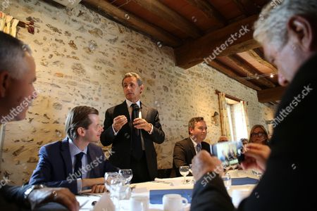 French Les Republicains deputy Guillaume Larrive, (left) with French former President and head of Les Republicains right-wing opposition party Nicolas Sarkozy during lunch at la Metairie Gourmande restaurant with Les Republicains mayors of the first circonscription in Yonne Region
