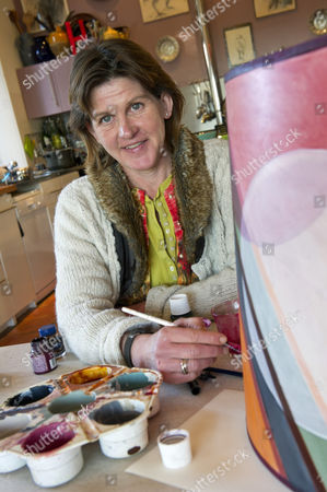Stock Photo of Designer Helena Barrowcliff at her home studio showing some of her designs and lampshades.