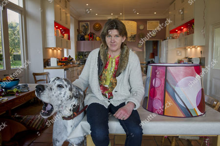 Designer Helena Barrowcliff at her home studio showing some of her designs and lampshades.