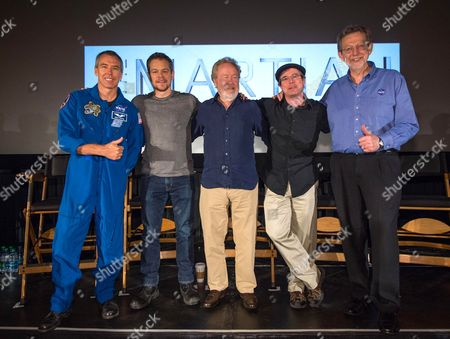 Stock Image of NASA Astronaut Drew Feustel, left, Actor Matt Damon, Director Ridley Scott, Author Andy Weir, and Director of the Planetary Science Division at NASA Headquarters Jim Green