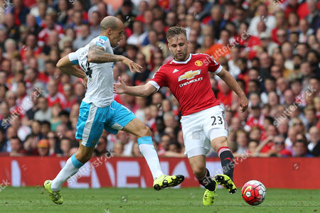 Gabriel Obertan competes with Luke Shaw during the Barclays Premier League clash match between Manchester United and Newcastle United,  at Old Trafford, Manchester