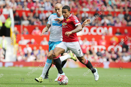 Memphis Depay competes with Gabriel Obertan during the Barclays Premier League clash match between Manchester United and Newcastle United,  at Old Trafford, Manchester