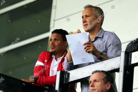 John Salako and Keith Millen of the Crystal Palace Coaching staff look on