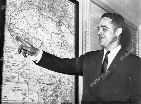 Robert Sargent Shriver, Jr., U.S. Statesman and Activist, Portrait Pointing at Map of Africa While Director of Peace Corps, 1961