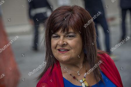 Senator Stefania Pezzopane awaits the arrival of Italian Prime Minister Matteo Renzi in L'Aquila