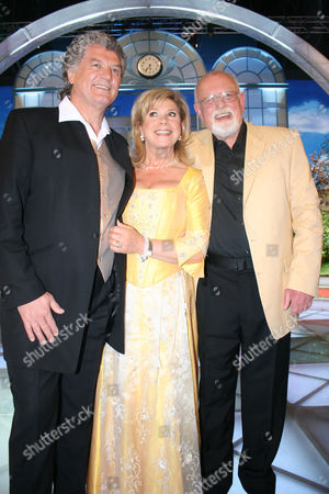 Roger Whittaker standing next to Marianne and Michael at the Spring Festival of Folk Music at the Erdgas Arena, Riesa, Saxony, Germany