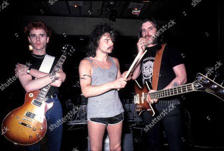 Stock Image of Motorhead - (c) Philthy Animal Taylor, (r) Lemmy- 1985