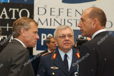 Secretary General, Jaap de Hoop Scheffer, General Harald Kujat (NATO Chairman of the Military Committee) and Ed Kronenburg (Director of the Private Office, NATO)