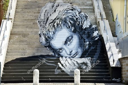 Ingrid Bergman mural on a set of steps by street artist Diavù (David Vecchiato)