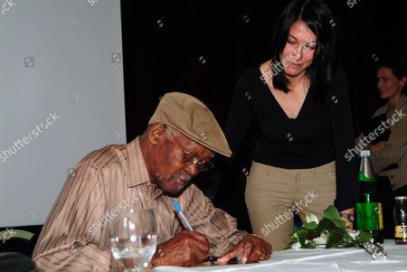 Cuban musician Ibrahim Ferrer, Buena Vista Social Club, giving autographs, Innsbruck, Austria