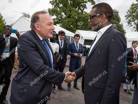 Youssou N'dour and French employers' association Medef President Pierre Gattaz