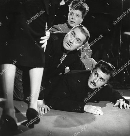 Irene Handl, George Street and Stewart Granger [Legs belong to Mary Stone]