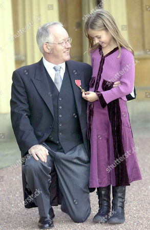 Brian Bennett with his OBE and granddaughter Alice