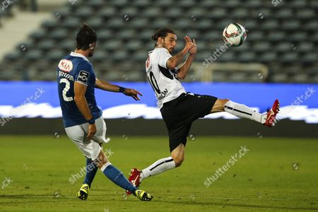 Stock Picture of Belenenses's defender Joao Amorim (L) vies for the ball with Altach's midfielder Patrick Salomon (R)