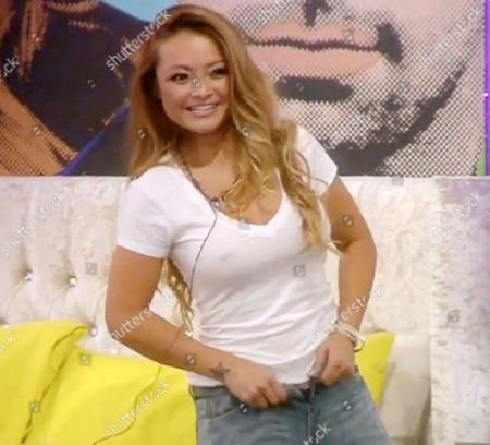 Tila Tequila putting on her jeans