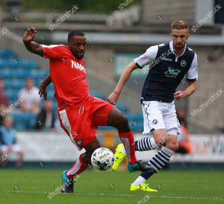 Chesterfield player Sylvan Ebanks-Blake shields the ball from Millwall player Mark Beevers during the Sky Bet League 1 match between Millwall and Chesterfield at The Den, London