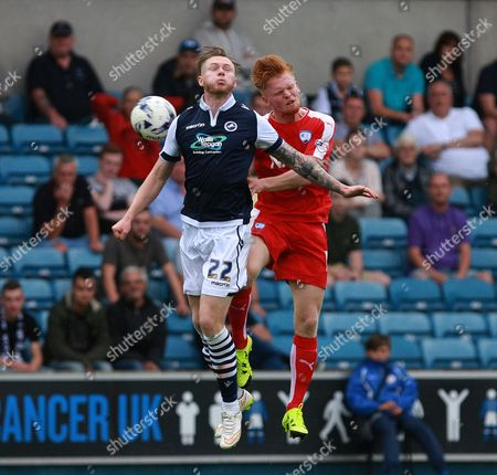 Millwall player Aiden O'Brien and Chesterfield player Liam O'Neill compete for a high ball during the Sky Bet League 1 match between Millwall and Chesterfield at The Den, London