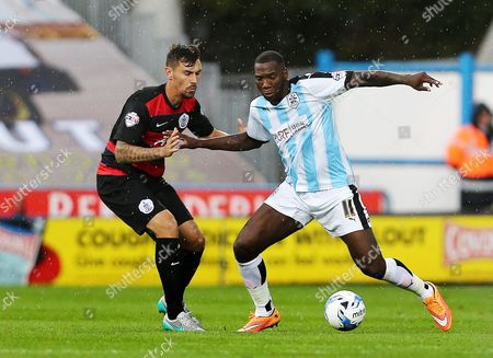 Grant Hall of QPR and Ishmael Miller of Huddersfield Town during the Sky Bet Championship match between Huddersfield Town and QPR played at the John Smith's stadium, Huddersfield