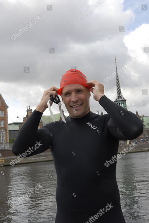 US Ambassador Rufus Gifford joined members of Veterans in Motion and 3300 others in an open water swimming event that takes palace in the canal around the Christiansborg Palace (Danish paliament)
