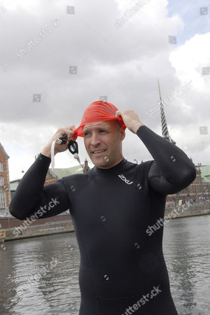 Stock Image of US Ambassador Rufus Gifford joined members of Veterans in Motion and 3300 others in an open water swimming event that takes palace in the canal around the Christiansborg Palace (Danish paliament)