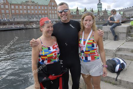 Stock Picture of US Ambassador Rufus Gifford joined members of Veterans in Motion and 3300 others in an open water swimming event that takes palace in the canal around the Christiansborg Palace (Danish paliament)