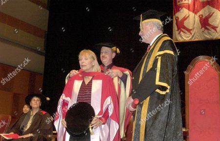 Joni Mitchell receiving the degree from Dick Pound