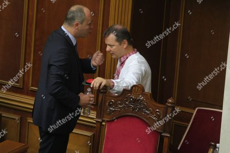 Stock Photo of Discussion between Andriy Parubiy (L) and Oleg Lyashko (R) is seen as they discuss the changes to the Ukrainian Constitution