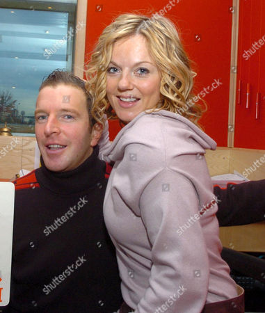 Stock Photo of George Bowie and Geri Halliwell. Geri Halliwell visiting Radio Clyde to promote her new single 'Ride It', she also helped a listener win £2100 on air
