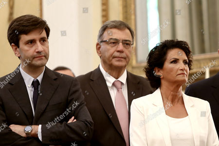 New Greek interim Finance Minister George Chouliarakis (L) with new Minister of Economy, Infrastructure and Merchant Marine Nikos Christodoulakis (C) and new Minister of Tourism, singer Alkistis Protopsalti (R) at the Swearing in ceremony and first Cabinet meeting
