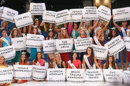 In celebration of the upcoming Miss America Competition (9/13), reigning Miss America, NY's own Kira Kazantsev (center, holding End Domestic Abuse sign), and the 52 contestants competing for the 2016 title take over Times Square.