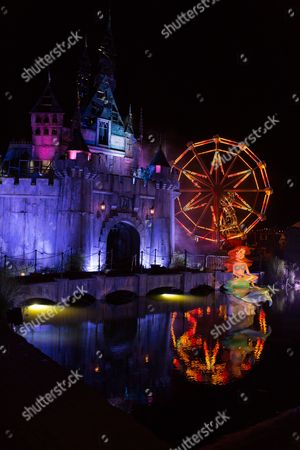 Stock Picture of Banksy's Dismaland lit up at night