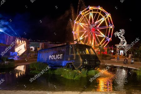 Stock Image of Banksy's Dismaland lit up at night