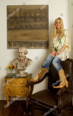 Suzanne Mizzi in front of one of her paintings