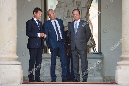 Manuel Valls, Francois Rebsamen and Francois Hollande at the French government weekly cabinet at Elysee palace.